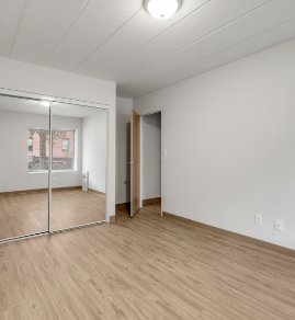 the bedroom with a hardwood floor